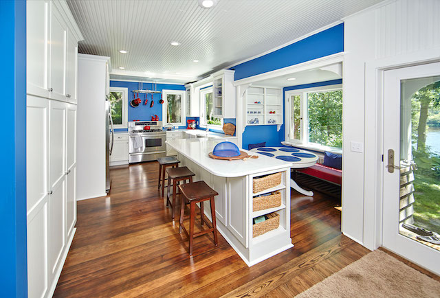 Rich natural wood floor complements vivid paint at this remodeled St. Croix River kitchen.