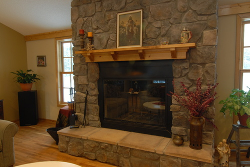 Stone fireplace surround and raised hearth