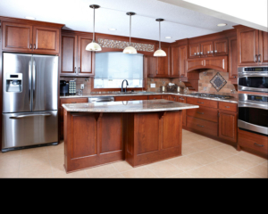 Stepped kitchen  island supports curved top