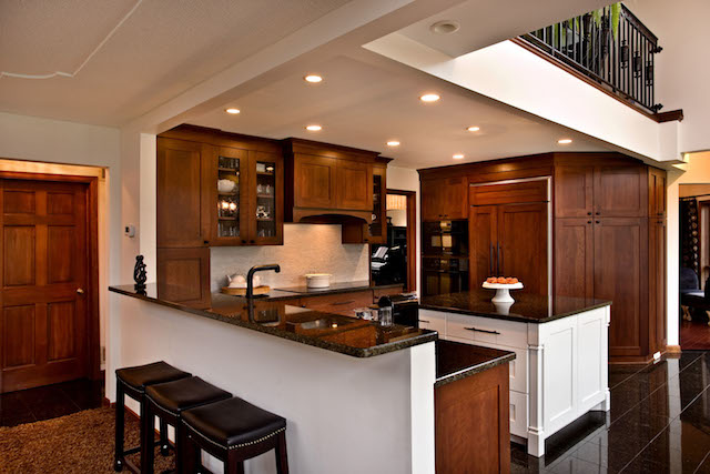 North Oaks kitchen with dark wood cabinets and painted center island