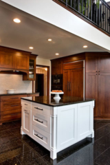 APEX North Oaks kitchen with painted center island and dark natural cabinets.