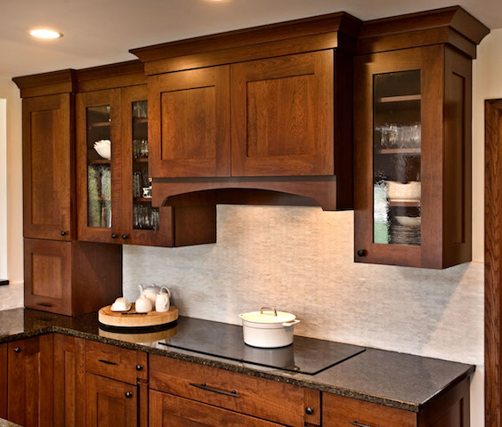 APEX North Oaks kitchen with dark cherry cabinets and display glass.