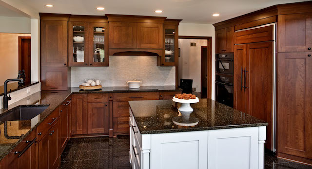 APEX North Oaks kitchen with cherry panel covered appliances.