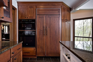 APEX Oaks kitchen with wall oven and concealed refrigerator