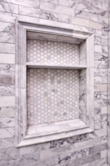 Marble and mosaic tile shower niche