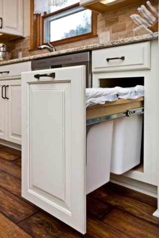 Dual recycling center in white cabinets