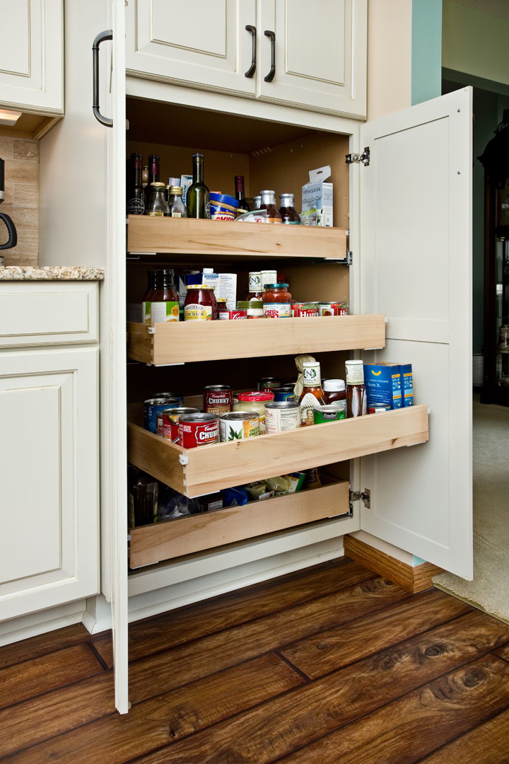 Pantry cabinet with pull-out shelves.