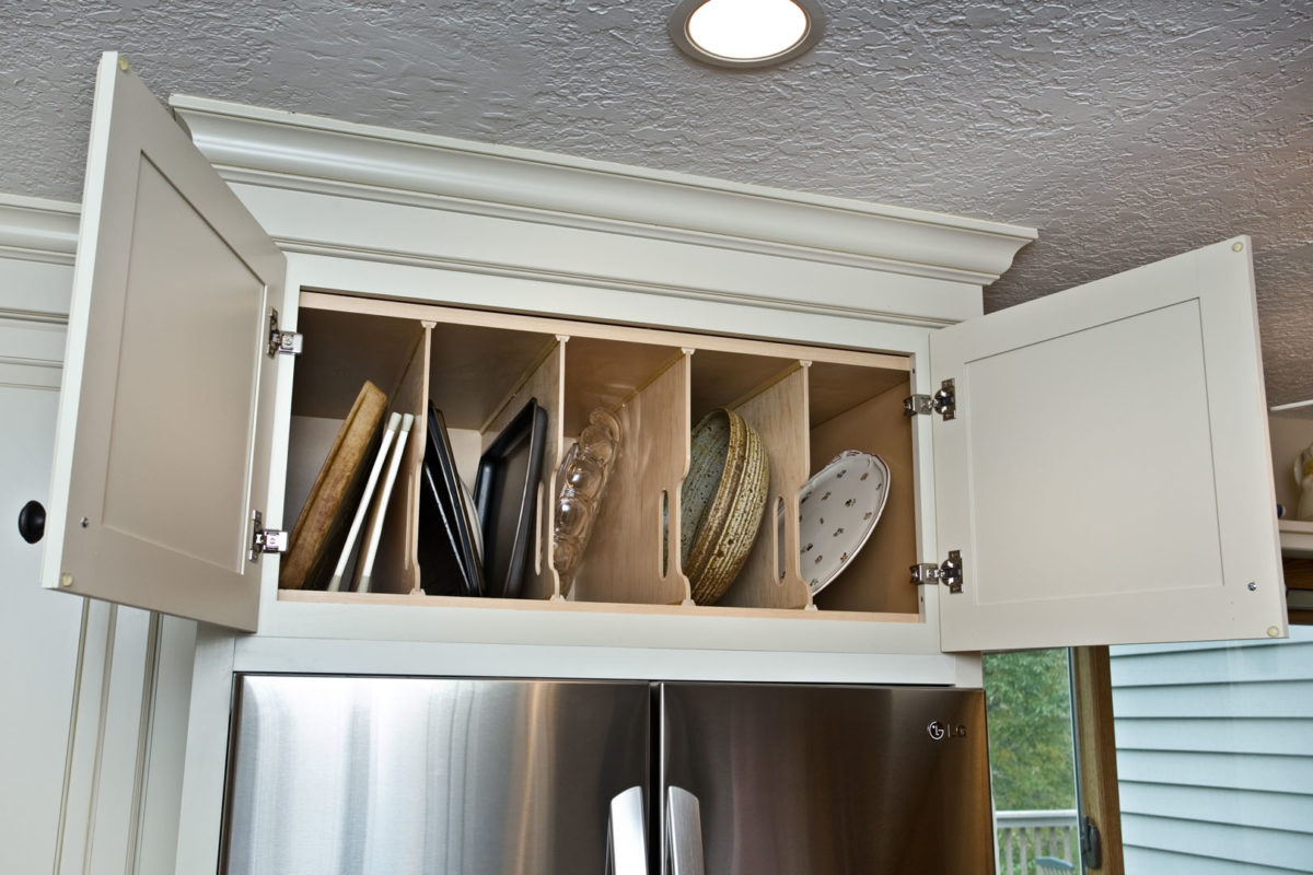 Vertical tray storage over fridge.