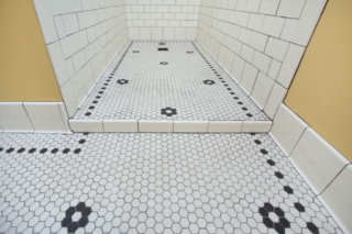 Curbless shower with mosaic tile floor