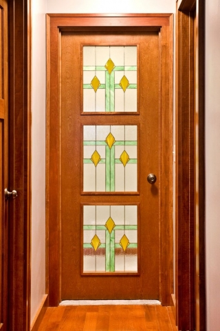 Master suite door with stained glass panels