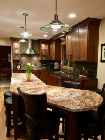 Kitchen with large counter-height dogleg island