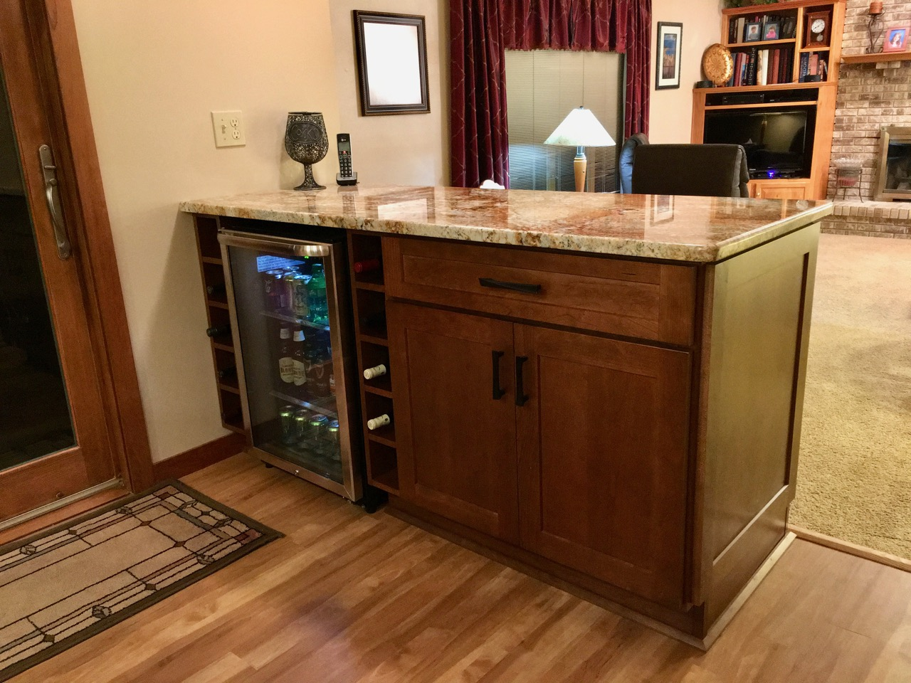 Cherry beverage bar separates kitchen and family room