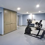laundry and exercise space in basement