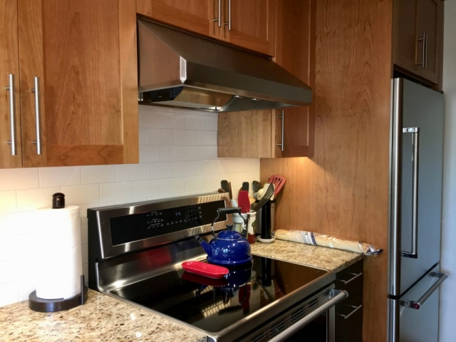 Cherry cabinets, granite tops and stainless appliances
