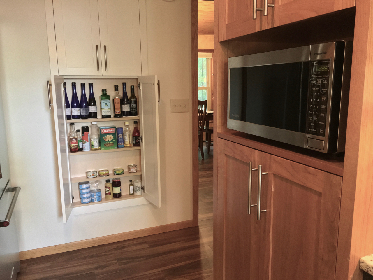 Shallow cabinet over stairs, microwave cubby