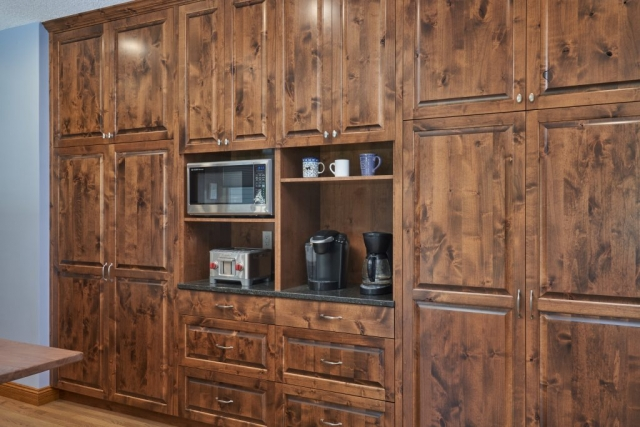 Knotty Alder cabinetry wall