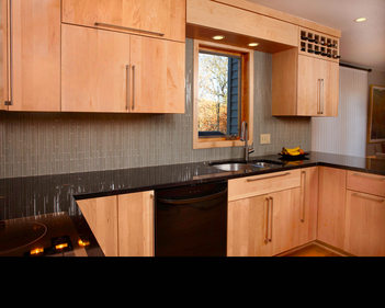 Eden Prairie kitchen with light wood and dark counters i