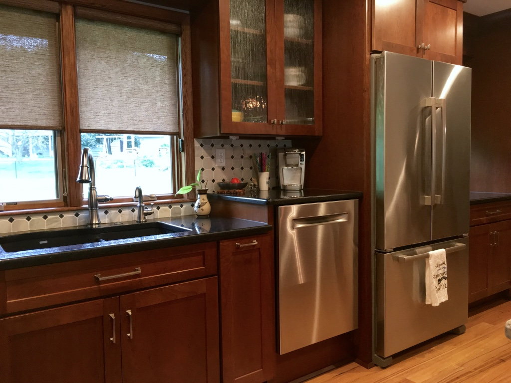 Cherry kitchen with raised dishwasher