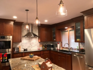 Ceiling-height cherry cabinets with stainless appliances