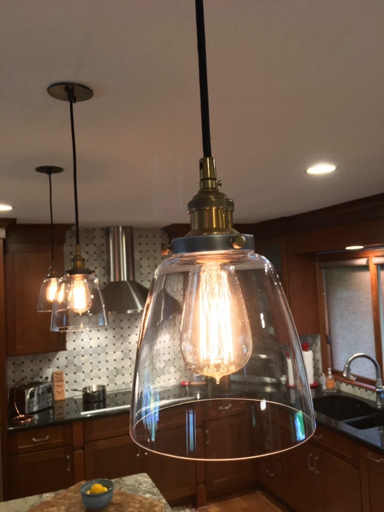 Vintage pendant lights over center island