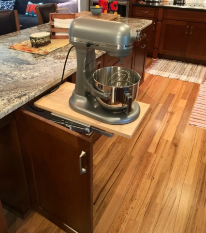 Easy-lift stand mixer station in cherry kitchen