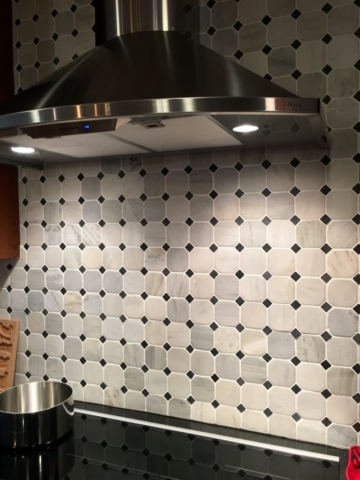 diamond-accented tile backsplash over cooktop