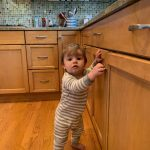 toddler in healthy kitchen